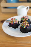 Chocolate ball with topping Stock Images