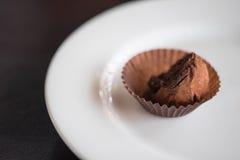 Chocolate ball on white plate stock photo