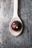 Chocolate ball in wooden spoon Royalty Free Stock Photography