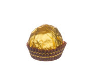 Chocolate ball wraped with golden foil isolated on white Stock Images