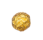 Chocolate ball wraped with golden foil isolated on white Royalty Free Stock Photo