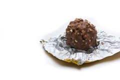 Chocolate ball on wrapping Royalty Free Stock Images