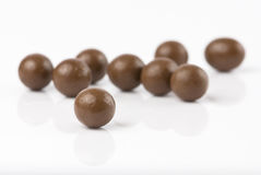 Chocolate balls. Isolated on white with reflection Royalty Free Stock Photography