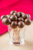 Chocolate balls. On stick in glass Royalty Free Stock Images