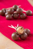 Chocolate balls. On stick on red towel Stock Photography