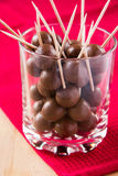 Chocolate balls. On stick in glass Stock Image