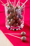 Chocolate balls. On stick in glass Royalty Free Stock Image