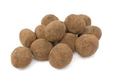Chocolate balls. Delicious chocolate balls on a white background Stock Photography