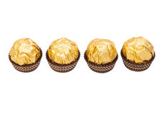 Chocolate balls with almond in gold foil paper Stock Photography