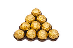 Chocolate balls with almond in gold foil paper Royalty Free Stock Images