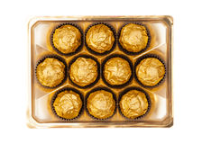 Chocolate balls with almond in gold foil paper on white. Isolated Royalty Free Stock Image