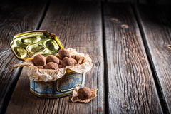 Chocolate balls in blue box sprinkled with cocoa Royalty Free Stock Image