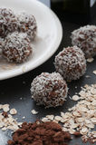 Chocolate Balls. Chocolate candy balls rolled in grated coconut royalty free stock image