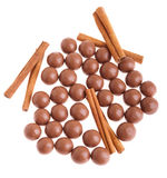 Chocolate balls and cinnamon sticks Stock Photo