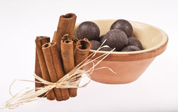 Chocolate balls and cinnamon sticks isolated Stock Image