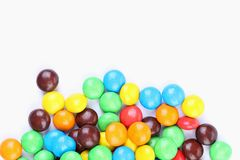Chocolate balls in colorful glaze are bottom. Stock Photo