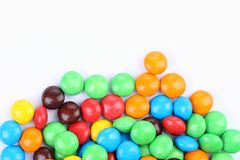 Chocolate balls in colorful glaze are bottom. Stock Images