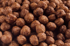 Chocolate balls corn flakes closeup background. Stock Images