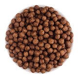 Chocolate balls corn flakes in white bowl isolated, top view. Cereals. Royalty Free Stock Images