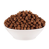 Chocolate balls corn flakes in white bowl isolated on white background. Cereals. Stock Image