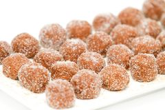 Chocolate balls covered with sugar on a plate Stock Photos