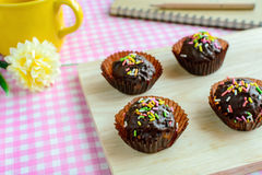 Chocolate balls with fancy topping on wooden plate Stock Photography