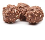 Chocolate balls filled with hazelnuts Stock Photo