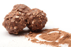 Chocolate balls filled with hazelnuts and a heart Royalty Free Stock Photos