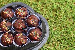 The chocolate balls on ground. The chocolate balls yummy on underground Royalty Free Stock Photo