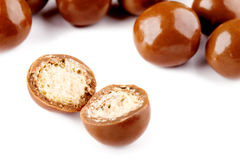 Chocolate balls and half with crisp filling Royalty Free Stock Photos