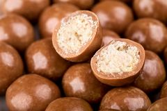 Chocolate balls and halves Royalty Free Stock Photo