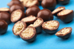 Chocolate balls and halves with crisp filling Stock Images