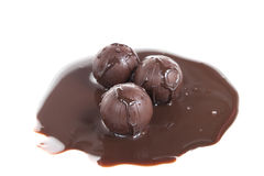 Chocolate balls with liquid chocolate Stock Photo