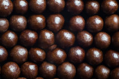 Chocolate balls macro Stock Images