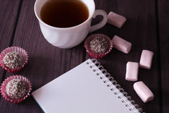 Chocolate balls, marshmallows and notebook Royalty Free Stock Images