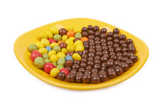 Chocolate balls and multicolored peanut glaze Royalty Free Stock Images
