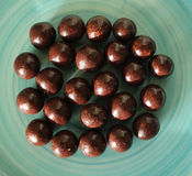 Chocolate balls. Some chocolate balls on a plate Stock Images