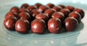 Chocolate balls. Some chocolate balls on a plate Royalty Free Stock Image