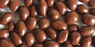 Chocolate balls. Some chocolate balls with white background Royalty Free Stock Photo
