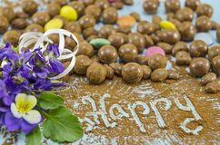 Chocolate balls on a table with the word Happy Royalty Free Stock Image