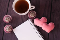 Chocolate balls, teaand notebook Royalty Free Stock Photography