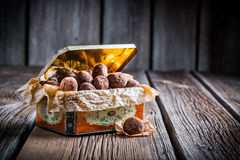 Chocolate balls in vintage box Stock Images