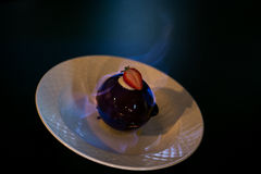 Chocolate balls on white plate royalty free stock photography