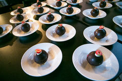 Chocolate balls on white plate royalty free stock photos