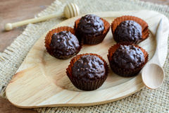 Chocolate balls on wooden plate Royalty Free Stock Photo