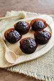 Chocolate balls on wooden plate Royalty Free Stock Images