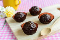 Chocolate balls on wooden plate Stock Photo