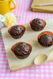Chocolate balls on wooden plate Royalty Free Stock Photography