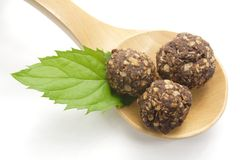 Chocolate balls on wooden spoon Royalty Free Stock Photography