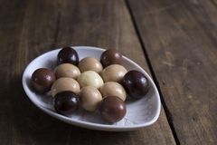 Chocolate balls on wooden table Royalty Free Stock Photos
